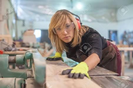 54552003-female-carpenter-using-electric-sander-female-carpenter-using-electric-sander-for-wood
